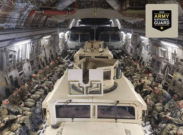 Ohio Army National Guard Hummers on a plane