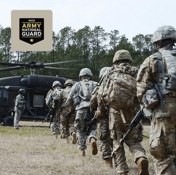 Ohio Army National Guard Servicemen gettin on Blackhawk