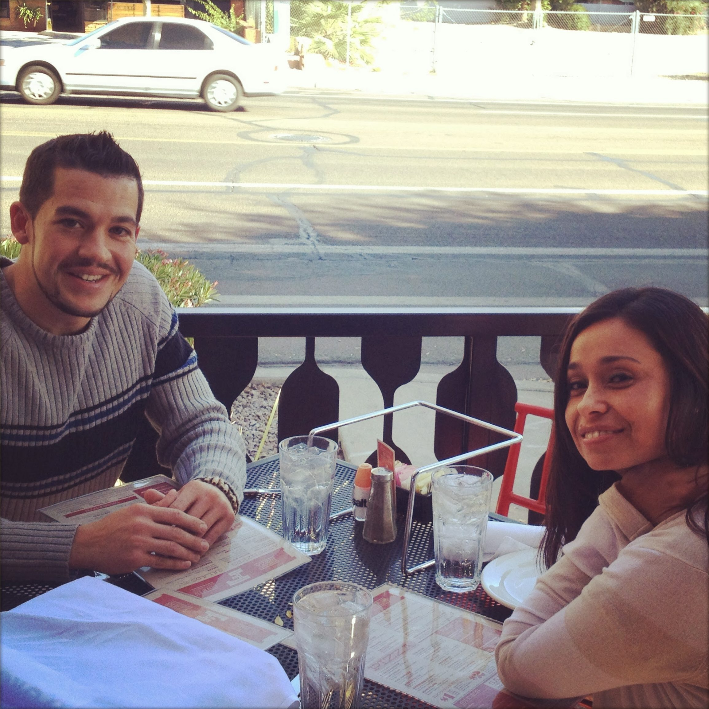 Natasha & Eric outside discussing the beginnings of our cross-cultural marketing agency.