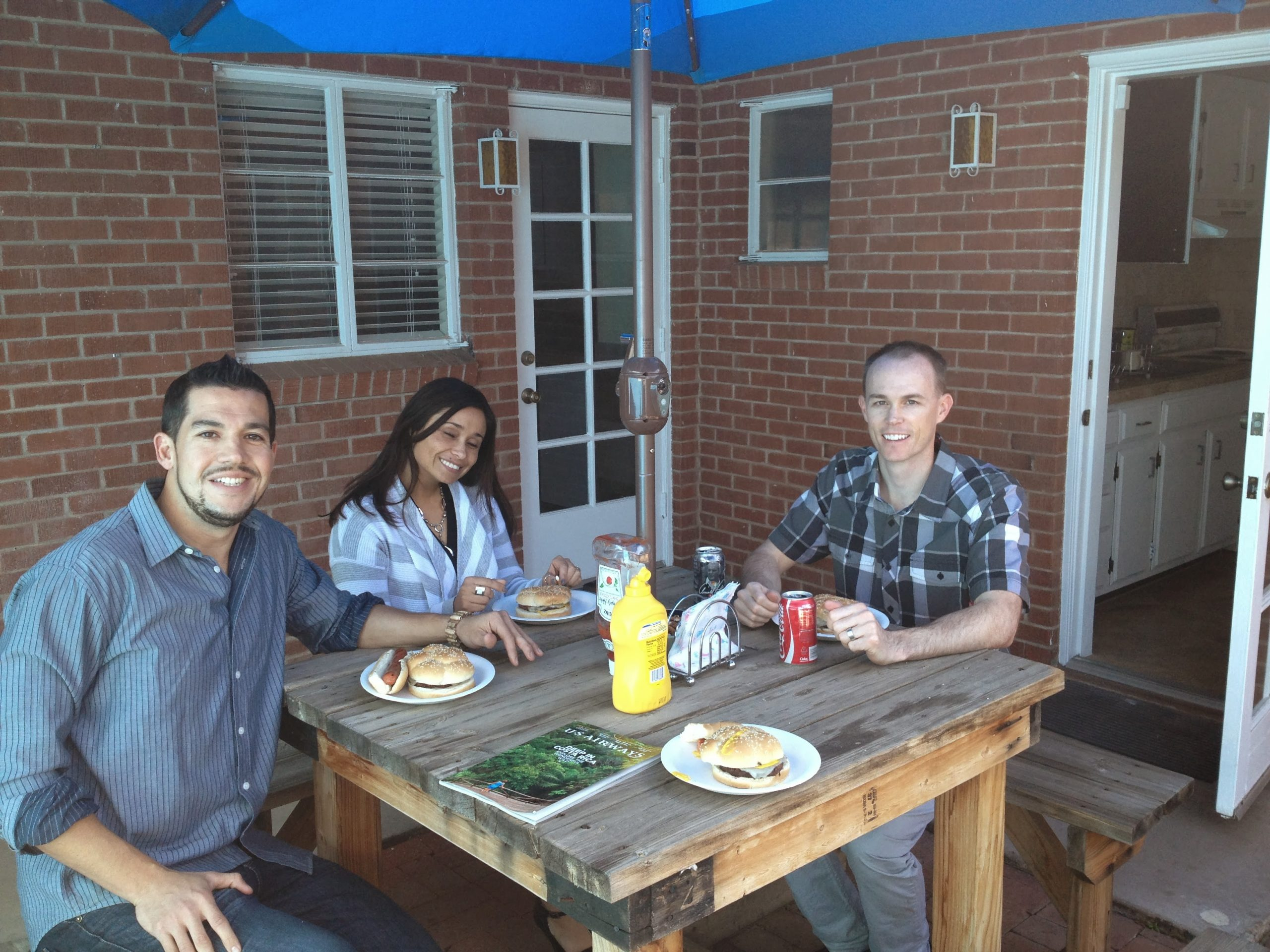Natasha, Eric, and a fellow colleague sitting outside of the newly opened cross-cultural marketing agency office.